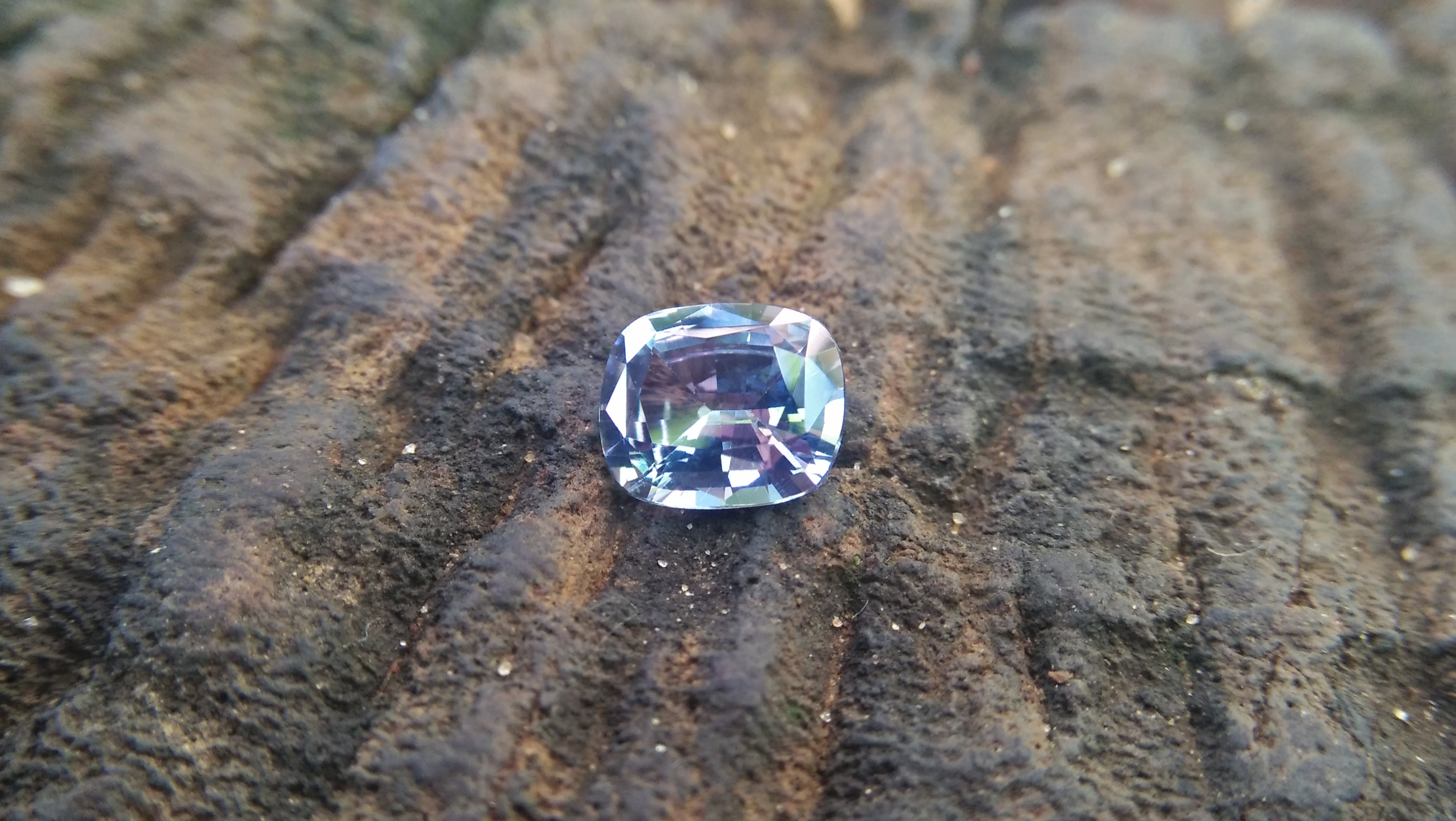 NATURAL BLUEISH WHITE SAPPHIRE Shape : Cution Dimension : 7.2mm x 6mm x 3.5mm Weight : 1.35cts Clarity : Clean Colour : Blueish white Transparency : Transparent Origin : Sri Lanka Treatment : Unheated/ Natural