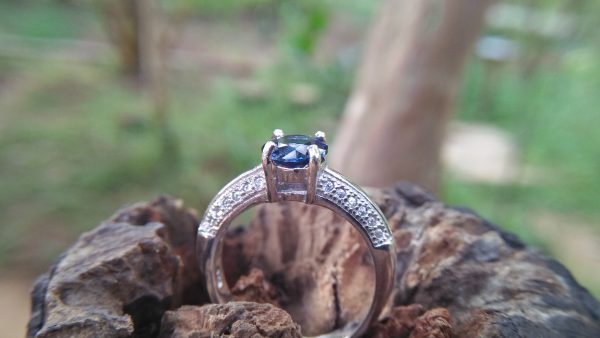 Natural Blue Spinel Standard 925 Silver Ring Stone : Natuarl Blue Sapinel Shape : Round Brilliant Cut ( Diamond Cut) Clarity : Clean Treatment : Natural/Unheated Dimension : 6.1 mm x 3.1mm Mineral : City of gem Ratnapura Sri Lanka Metal : Standard 925 Silver Other : Also, We attached 24 AD's (American Diamond) to get more luster & More Beauty.