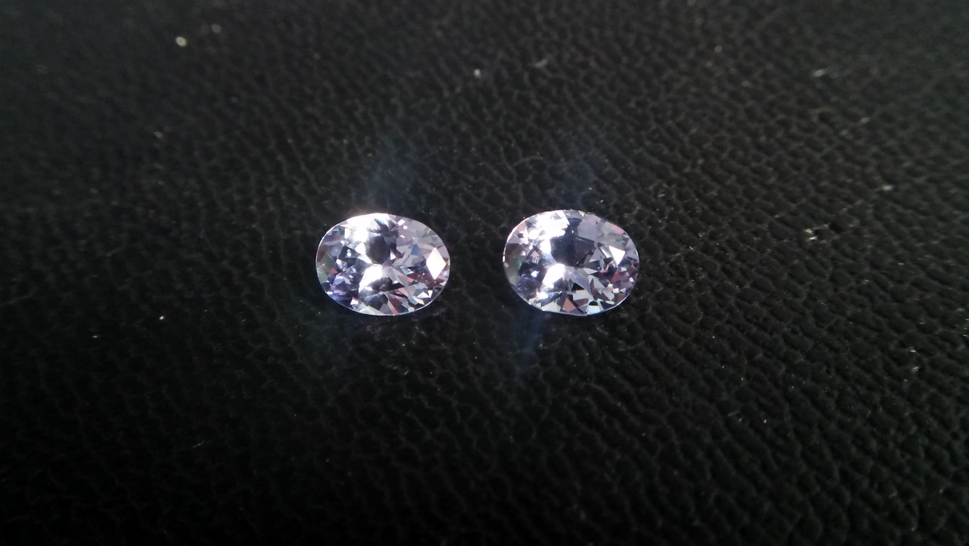 NATURAL Lavender Spinel Pair Shape : Ovel Clarity : SI Treatment : Natural/Unheated Dimension : 6.5mm x 5mm x 3mm ( Both Same) Weight : 1.45Cts (Both) Cut : Flower Cut Dispersion : Good Colour : Light Lavender