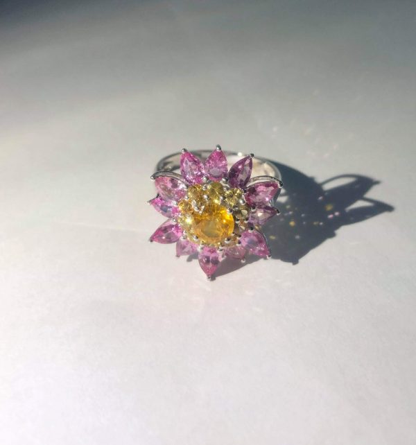 Ceylon Natural Yellow Sapphire & Pink Sapphire Diamond 18K White Gold Flower Ring Main Stone : Ceylon Yellow Sapphire Main Stone Weight : 0.82Cts Other : Small Pink Sapphire & Yellow Sapphire 3.28Cts Metal : 18K White Gold Made from : Japan Weight : 5.2g High Quality Jewellery Made in Japan & Stones from Sri Lanka