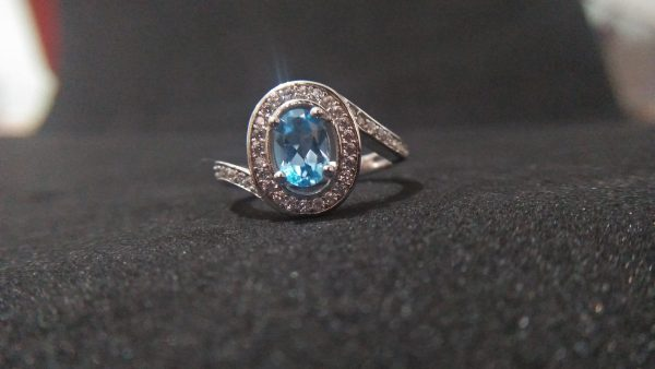 Blue Topaz Silver Ring Stone : Blue Topaz Stone Shape: Oval Clarity : Clean Dimension : 6.9mm x 5.4mm Metal : Standard 925 Silver Weight : 3.47g Type : Ladies Design Blue Topaz Silver Ring Topaz is a silicate mineral of aluminum and fluorine with the chemical formula Al₂SiO₄(F, OH)₂. Topaz is excellent for cleansing the aura, and for relaxing and releasing tension at any level. It is highly empathic to the system and directs its energy to where it is needed most, aligning the meridians of the body. Silver is a chemical element with symbol Ag and atomic number 47. A so Silver is the metal of emotions, of the psychic mind, and of loving as well as healing. It is used to bring patience and perseverance to the wearer