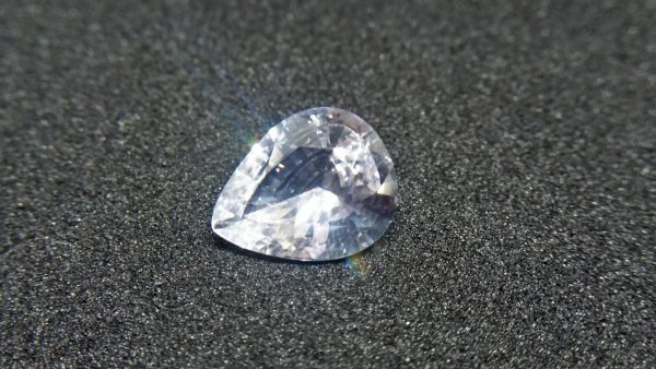 "Ceylon White Sapphire Weight : 2.45Cts Dimension : 10.3 mm x 8.4 mm x 4.2 mm Color : White Treatment : Heated Transparent: Good Transparency Shape : Pear Clarity : VS Danu Group - Gemstones Directly from the Source COLORED STONE LABORATORY CERTIFIED ( GIA Alumni Association Member) CSL Memo NO : 166CD6D4BD14 Sapphire is a precious gemstone, a variety of the mineral corundum, consisting of aluminum oxide with trace amounts of elements such as iron, titanium, chromium, copper, or magnesium. Sapphire deposits are found in Eastern Australia, Thailand, Sri Lanka, China, Vietnam, Madagascar, Greenland, East Africa, and in North America in mostly in Montana. Madagascar, Sri Lanka, and Kashmir produce large quantities of fine quality Sapphires for the world market. Sapphires are mined from alluvial deposits or from primary underground workings. Blue Sapphire and Ruby are the most popular Gemstone in Corundum Family. also, Orangy Pink Sapphire is called Padparadscha. The name Drive's from the Sinhalese word ""padmaraga"" "" පද්මරාග"", meaning lotus blossom, as the stone is of a similar color to the lotus blossom. Bi-Color Sapphire from DanuGroup Collection Also, Sapphire can be found as parti-color, bi-color or fancy color. Australia is a main parti-color Sapphire producer. White Sapphire also, White sapphire is a very popular stone to wear instead of Diamond as a 3rd hardness gemstone after diamond ( moissanite hardness is 9.5). Various colors of star sapphires A star sapphire is a type of sapphire that exhibits a star-like phenomenon known as asterism. Also, A rare variety of natural sapphire, known as color-change sapphire, exhibits different colors in a different light. Sapphires can be treated by several methods to enhance and improve their clarity and color. A common method is done by heating the sapphires in furnaces to temperatures between 500 and 1,850 °C for several hours, or by heating in a nitrogen-deficient atmosphere oven for 1 week or more. Geuda is a form of the mineral corundum. Geuda is found primarily in Sri Lanka. It's a semitransparent and milky appearance due to rutile inclusions. Geuda is used to improve its color by heat treatment. Some geuda varieties turn to a blue color after heat treatments and some turn to red after oxidizing. Also, Kowangu pushparaga turns to yellow sapphire after oxidizing. Sapphire Crystal system is a Trigonal crystal system with a hexagonal scalenohedral crystal class. Sapphire hardness is 9 according to the Mohs hardness scale with 4.0~4.1 specific gravity. Refractive index ω          =1.768–1.772 nε =1.760–1.763 Solubility = Insoluble Melting point = 2,030–2,050 °C Birefringence  = 0.008 Pleochroism = Strong Luster = Vitreous Sapphire is the birthstone for September and the gem of the 45th anniversary. Healing Properties of Sapphire Sapphire releases mental tension, depression, unwanted thoughts, and spiritual confusion.  Sapphire is known as a ""stone of Wisdom"". It is exceptional for calming and focusing the mind, allowing the release of mental tension and unwanted thoughts. Sapphire is also the best stone for awakening chakras. Dark Blue or Indigo Sapphire stimulates the Third Eye chakra. Blue Sapphire stimulates the Throat Chakra. Green sapphire stimulates Heart Chakra. Black Sapphire stimulates Base Chakra. White sapphire stimulates Crown Chakra. Yellow sapphire stimulates Solar Plexus Chakra. White Sapphire brings wisdom and strength of spirit. It stimulates the pineal and pituitary glands and also beneficial in gathering courage. White Sapphire stimulates the Crown Chakra. It helps to balance crown chakra to balance your energies. When crown chakra balance, energies are balance. As a pure Aluminium Oxide crystal, White Sapphire clears the mind during meditation. Its vibrant energies help to reduce stress and keep calm your mind during meditation."