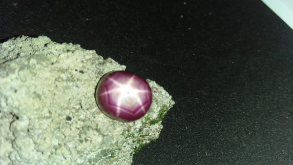 "Ceylon Natural Star Ruby A star sapphire is a type of sapphire that exhibits a star-like phenomenon known as asterism. Star sapphires contain intersecting needle-like inclusions following the underlyingcrystal structure that causes the appearance of a six-rayed ""star""-shaped pattern when viewed with a single overhead light source. Healing Properties Sapphire helps the user stay on the Spiritual Path, boosting psychic and spiritual powers, and is a great stone for Earth and Chakra healing. also, all corundums share some energies in common, the various colours of Sapphire have individual vibrational signatures and different spiritual properties. Sapphire was used by the Etruscans over 2,500 years ago and was also prized in ancient Rome, Greece and Egypt. Revered as a stone of royalty, sapphire was believed to keep kings safe from harm or envy."