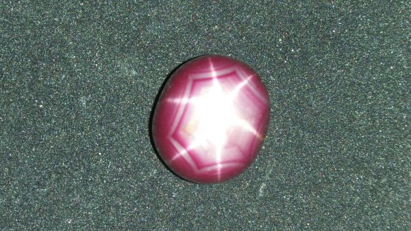 """Ceylon Natural Star Ruby A star sapphire is a type of sapphire that exhibits a star-like phenomenon known as asterism. Star sapphires contain intersecting needle-like inclusions following the underlyingcrystal structure that causes the appearance of a six-rayed """"star""""-shaped pattern when viewed with a single overhead light source. Healing Properties Sapphire helps the user stay on the Spiritual Path, boosting psychic and spiritual powers, and is a great stone for Earth and Chakra healing. also, all corundums share some energies in common, the various colours of Sapphire have individual vibrational signatures and different spiritual properties. Sapphire was used by the Etruscans over 2,500 years ago and was also prized in ancient Rome, Greece and Egypt. Revered as a stone of royalty, sapphire was believed to keep kings safe from harm or envy."""