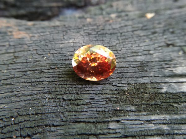 Ceylon Natural Jacinth Zircon Colour : Orangy Brown Shape : Oval Weight : 8.48 CTS Dimension : 12.1 x 10.2 x 7.2 mm Treatment : None/Unheated Clarity : Clean • CSL - Colored Stone Laboratory Certified ( GIA Alumina Association Member ) • CSL Memo No : ABD49DE09EA9