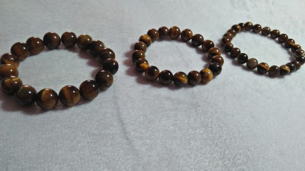 Tiger Eye Bracelet  Stone : Natural Tiger Eye Shape : Round Size : 8.8mm / 10.3mm / 12mm Treatment : Unheated / Natural Design : GenTiger Eye Bracelet  Stone : Natural Tiger Eye Shape : Round Size : 8.8mm / 10.3mm / 12mm Treatment : Unheated / Natural Design : Gent / Ladies Botht / Ladies Both