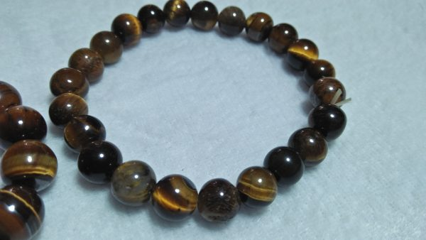 Tiger Eye Bracelet  Stone : Natural Tiger Eye Shape : Round Size : 8.8mm / 10.3mm / 12mm Treatment : Unheated / Natural Design : Gent / Ladies Both