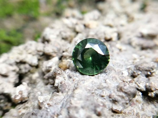 Ceylon Natural Beccarite 绿色锆石 Beccarite is green colour Veriety of Zircon Family. Zircon is a mineral belonging to the group of nesosilicates. Its chemical name is zirconium silicate, and its corresponding chemical formula is ZrSiO₄.Green Zircon is rare Colour Type of Zircon family. Zircon is ubiquitous in thecrustof Earth. It occurs as a commonaccessory mineralinigneous rocksinmetamorphic rocksand as detrital grains insedimentary rocks. Zircon is also very resistant to heat and corrosion. Because of theiruraniumandthorium content, some zircons undergometamictization. Connected to internal radiation damage, these processes partially disrupt the crystal structure and partly explain the highly variable properties of zircon. As zircon becomes more and more modified by internal radiation damage, the density decreases, the crystal structure is compromised, and the color changes