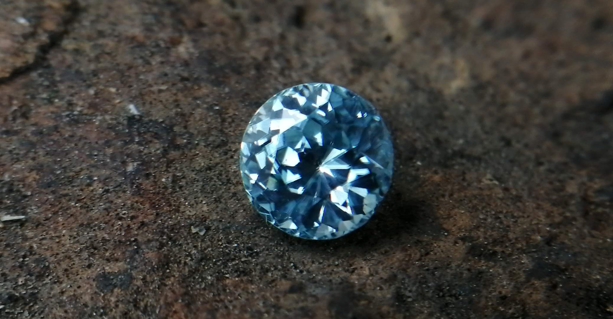 """Colour: Light Green-Blue Shape: Round Weight : 2.31 Cts Dimension : 6.9 x 6.8 x 5.3 mm Locality: Cambodia Treatment: No identification of heat treatment on the Lab Report. but, Blue Zircon is Heated Clarity : VS • CSL - Colored Stone Laboratory Certified ( GIA Alumina Association Member ) • CSL Memo No: 82E5EB04FC43 Blue Zircon Stimulates Throat Chakra. It is a very popular gemstone in the new fashion world for brilliance pieces of jewelry. Zircon is a nesosilicates group mineral. Its corresponding chemical formula is ZrSiO4. The name derives from the Persian zargun, meaning """"gold-hued"""". Zircon is a popular gemstone that has been used for nearly 2000 years. The crystal structure of zircon is a tetragonal crystal mineral with 7.5 hardness according to the Mohs Hardness scale. Zircon is also very resistant to heat and corrosion and known as Insoluble gemstone. This Uniaxial (+) mineral Specific gravity is 4.6–4.7. It's heavy more than such as Sapphire, chrysoberyl, Garnets, spinels. Gem Businessmen use these physical properties to identify zircons from other gemstones. Zircon has weak pleochroism and has colors such as Colorless, Very Strong Blue To Green-Blue, Yellow, Blue-Green, Yellowish Green, Yellow-Green, Brown, Orangy Yellow To Reddish Orange, Dark Brownish Red, Sometimes Purple, Gray To Bluish Gray, Brownish Gray. Colorless specimens that show gem quality are a popular substitute for diamond and are also known as """"Matara diamond"""". Zircon has been classified into three types called high zircon, intermediate zircon ( medium zircon ), and low zircon. Some Quality Type brown zircons can be transformed into colorless and blue zircons by heating to 800 to 1000 °C. There are Some using names for Zircon such as Hyacinth or jacinth: yellow-red, orange, red-brown to brown, Jargoon or jargon: light yellow to colorless stones, Beccarite: green zircon, Melichrysos: straw yellow, Starlite: blue heat treated zircon, Sparklite: colorless zircon. Zircon is found in Madagascar,"""
