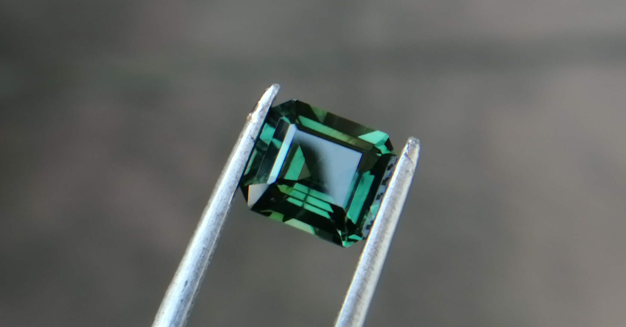 """Natural Green Sapphire Colour : Green Shape : Octagon Weight : 1.52 CTS Dimension : 6.8 x 6.0 x 3.7 mm Treatment : Unheated Clarity : VS • CSL - Colored Stone Laboratory Certified ( GIA Alumina Association Member ) • CSL Memo No : C25A834CB509 Sapphire is a precious gemstone, a variety of the mineral corundum, consisting of aluminum oxide with trace amounts of elements such as iron, titanium, chromium, copper, or magnesium. Sapphire deposits are found inEastern Australia,Thailand,Sri Lanka,China, Vietnam, Madagascar, Greenland, East Africa, and inNorth Americain mostly inMontana. Madagascar, Sri Lanka, and Kashmir produce large quantities of fine quality Sapphires for the world market. Sapphires are mined fromalluvialdeposits or from primary underground workings. Blue Sapphire and Ruby are the most popular Gemstone in Corundum Family. also, Orangy Pink Sapphire is called Padparadscha. The name Drive's from the Sinhalese word """"padmaraga"""" """" පද්මරාග"""", meaning lotus blossom, as the stone is of a similar color to the lotus blossom. Bi-Color Sapphire from DanuGroup Collection Also, Sapphire can be found as parti-color, bi-color or fancy color. Australia is a main parti-color Sapphire producer. White Sapphire also, White sapphire is a very popular stone to wear instead of Diamond as a 3rd hardness gemstone after diamond ( moissanite hardness is 9.5). Various colors of star sapphires Astar sapphireis a type of sapphire that exhibits a star-like phenomenon known asasterism. Also, A rare variety of natural sapphire, known as color-change sapphire, exhibits different colors in a different light. Sapphires can be treated by several methods to enhance and improve their clarity and color. A common method is done by heating the sapphires in furnaces to temperatures between 500 and 1,850°C for several hours, or by heating in a nitrogen-deficient atmosphere oven for 1 week or more. Geuda is a form of the mineralcorundum. Geuda is found primarily inSri Lanka. It's a semitransparent a"""