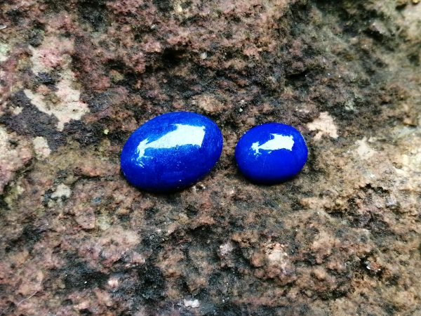 Weight : 4.55 Cts / 2.40 Cts Dimension : 14.0 x 10.0 x 4.0 mm 10.0 x 8.0 x 4.0 mm Colour : Blue Shape : Oval Treatment : Unheated Clarity : Opaque Lapis lazuli is a deep blue metamorphic ( arise from the transformation of existing rock types) rock used as a semi-precious stone, a mixture of minerals with lazurite as the main constituent. Lazurite is a tectosilicate mineral with sulfate, sulfur, and chloride. https://youtu.be/sczya3Xhk9o Lapis lazuli can be found colors such as Blue, or purple, mottled with white calcite and brassy pyrite. As Physical Properties, It has Uneven and Conchoidal fractures and a dull luster. Lapis Lazuli specific gravity is 2.7–2.9 with 5–5.5 hardness according to the Mohs hardness scale. The refractive index is Refractive Index1.500 to 1.670 as optical properties. The variations in composition cause a wide variation in the specific gravity, Refractive index and hardness values. At the end of the Middle Ages, lapis lazuli began to be exported to Europe, where it was ground into a powder and made into ultramarine, the finest and most expensive of all blue pigments. In ancient Egypt, lapis lazuli was a favorite stone for amulets and ornaments such as scarabs. Lapis lazuli is found in Afghanistan, Russia, Chile, Italy, Mongolia, Pakistan, the United States, and Canada. Afghanistan is the major source of lapis lazuli. Healing properties of Lapis lazuli 💎 Lapis lazuli associates with Throat Chakra and Third Eye Chakra. Lapis Lazuli activates the psychic centers at the Third Eye and balances the energies of the Throat Chakra. Also, Lapis lazuli is the September birthstone. Lapis Lazuli releases stress, bringing peace, harmony, and inner self-knowledge.  Lapis Lazuli boosts the immune system, purifies the blood and lowers blood pressure. Lapis is one of the oldest spiritual stones known to man, used by healers, priests and royalty, for power, wisdom and to stimulate psychic abilities and inner vision.