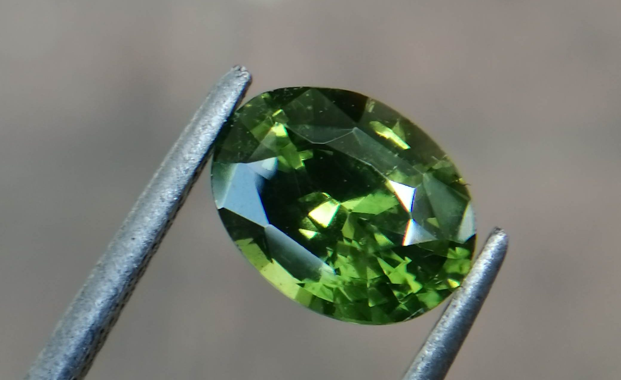 """Natural Green Zircon Sri Lanka - Beccarite Zircon Colour: Green Shape: Oval Weight : 1.85 Cts Dimension : 8.1 x 6.1 x 4.5 mm Treatment: Unheated Clarity : SI Origin : Sri Lanka Zircon is a nesosilicates group mineral. Its corresponding chemical formula is ZrSiO4. The name derives from the Persian zargun, meaning """"gold-hued"""". Zircon is a popular gemstone that has been used for nearly 2000 years. The crystal structure of zircon is a tetragonal crystal mineral with 7.5 hardness according to the Mohs Hardness scale. Zircon is also very resistant to heat and corrosion and known as Insoluble gemstone. This Uniaxial (+) mineral Specific gravity is 4.6–4.7. It's heavy more than such as Sapphire, chrysoberyl, Garnets, spinels. Gem Businessmen use these physical properties to identify zircons from other gemstones. Zircon has weak pleochroism and has colors such as Colorless, Very Strong Blue To Green-Blue, Yellow, Blue-Green, Yellowish Green, Yellow-Green, Brown, Orangy Yellow To Reddish Orange, Dark Brownish Red, Sometimes Purple, Gray To Bluish Gray, Brownish Gray. Colorless specimens that show gem quality are a popular substitute for diamond and are also known as """"Matara diamond"""". Zircon has been classified into three types called high zircon, intermediate zircon ( medium zircon ), and low zircon. Some Quality Type brown zircons can be transformed into colorless and blue zircons by heating to 800 to 1000 °C. There are Some using names for Zircon such as Hyacinth or jacinth: yellow-red, orange, red-brown to brown, Jargoon or jargon: light yellow to colorless stones, Beccarite: green zircon, Melichrysos: straw yellow, Starlite: blue heat treated zircon, Sparklite: colorless zircon. Zircon is found in Madagascar, Sri Lanka, Tanzania, Cambodia, Australia, Burma, Afghanistan, Canada, USA, Thailand, Russia, Mozambique, Norway. Healing Properties 👇 Zircon is known as """"The stone of virtue"""" All colors. It clears the auric negativity in the wearer and helps to communicate with the h"""