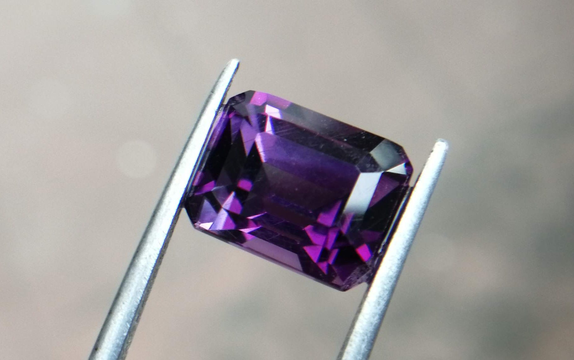 """Colour : Purple Shape : Octagon Weight : 5.35 Cts Dimension : 11.1 x 8.5 x 8.1 mm Treatment : Unheated Clarity : VS Natural Amethyst Amethyst is a violet variety of quartz. It's a birth stone of month February. The name comes from the Koine Greek ἀμέθυστος amethystos from ἀ- a-, """"not"""" and μεθύσκω methysko / μεθύω methyo, """"intoxicate"""", a reference to the belief that the stone protected its owner from drunkenness. Category: Silicate mineral Formula: SiO2 Crystal system: Trigonal Color: Purple, violet Mohs scale hardness: 7 Specific gravity: 2.65 Av Optical properties: Uniaxial (+) Refractive index: nω = 1.543–1.553                 nε = 1.552–1.554 Amethyst can be found in Sri Lanka, Madagascar, Zambia, Zimbabwe, USA, Brazil, Uruguay, Thailand, Turkey, Tanzania, Tajikistan, Switzerland, Sweden, Spain, South Korea, Africa, Russia, Afghanistan, New Zealand, Norway, Nigeria, Namibia, Myanmar, Mozambique, Morocco, Mongolia, Mexico, Kenya, Laos, Japan, Germany, France, Finland, China, Canada, Bulgaria, Cambodia, Australia, Belgium. Amethyst has healing powers to help with physical ailments, emotional issues, and in Energy Healing and Chakra balancing   Amethyst boosts the production of hormones, and stimulates the sympathetic nervous system and endocrine glands to optimum performance. It supports oxygenation in the blood, and aids in treatments of the digestive tract, heart, stomach, and skin.    The therapeutic uses of Amethyst have a long and well-documented history. Amethyst crystal therapies are primarily associated with physical ailments of the nervous system, the curing of nightmares and insomnia, and balancing the crown chakra. It's also excellent crystal for meditation to open Crown Chakra energies."""