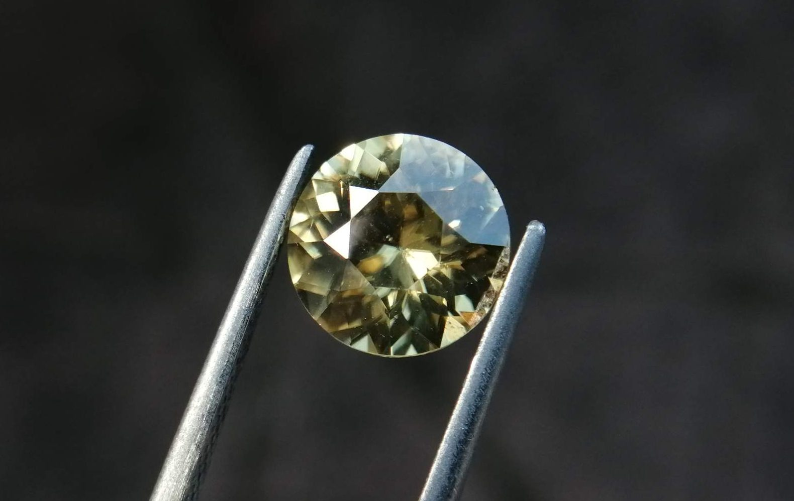 """Natural Yellow Zircon Sri Lanka Colour : Light Yellow Shape : Round Weight : 3.70 Cts Dimension : 9.1 x 5.5 mm Treatment : Traditional Low-temperature heating Clarity : VS Origin : Ratnapura, Sri Lanka Zircon is a nesosilicates group mineral. Its corresponding chemical formula is ZrSiO4. The name derives from the Persian zargun, meaning """"gold-hued"""". Zircon is a popular gemstone that has been used for nearly 2000 years. The crystal structure of zircon is a tetragonal crystal mineral with 7.5 hardness according to the Mohs Hardness scale. Zircon is also very resistant to heat and corrosion and known as Insoluble gemstone. This Uniaxial (+) mineral Specific gravity is 4.6–4.7. It's heavy more than such as Sapphire, chrysoberyl, Garnets, spinels. Gem Businessmen use these physical properties to identify zircons from other gemstones. Zircon has weak pleochroism and has colors such as Colorless, Very Strong Blue To Green-Blue, Yellow, Blue-Green, Yellowish Green, Yellow-Green, Brown, Orangy Yellow To Reddish Orange, Dark Brownish Red, Sometimes Purple, Gray To Bluish Gray, Brownish Gray. Colorless specimens that show gem quality are a popular substitute for diamond and are also known as """"Matara diamond"""". Zircon has been classified into three types called high zircon, intermediate zircon ( medium zircon ), and low zircon. Some Quality Type brown zircons can be transformed into colorless and blue zircons by heating to 800 to 1000 °C. There are Some using names for Zircon such as Hyacinth or jacinth: yellow-red, orange, red-brown to brown, Jargoon or jargon: light yellow to colorless stones, Beccarite: green zircon, Melichrysos: straw yellow, Starlite: blue heat treated zircon, Sparklite: colorless zircon. Zircon is found in Madagascar, Sri Lanka, Tanzania, Cambodia, Australia, Burma, Afghanistan, Canada, USA, Thailand, Russia, Mozambique, Norway. Healing Properties 👇 Zircon is known as """"The stone of virtue"""" All colors. It clears the auric negativity in the wearer and helps """